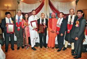 At the Pranav Ashram's Annual Fund Raising Dinner on Oct 3, from left: Dr Mohammad Unus Hack, Dhaman Kissoon, Pratiksha and Arun Gossai (daughter and son respectively of the late Sri Prakash Gossai), Sew Sanker, honoree, Swami Bhajanananda, David Singh, Brahma Kissoon and Sat Purushotam. (Photo by Ramesh Ramkalawan)
